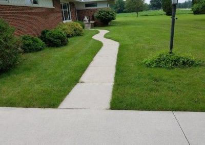 Sidewalk after power washing.