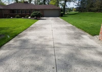 Driveway before power washing.