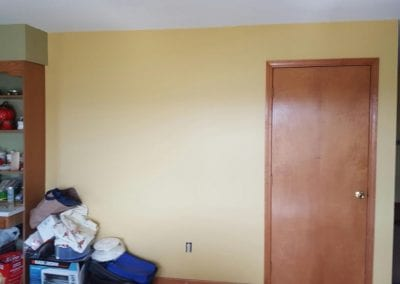 Interior of residence after painting and wall paper removal.