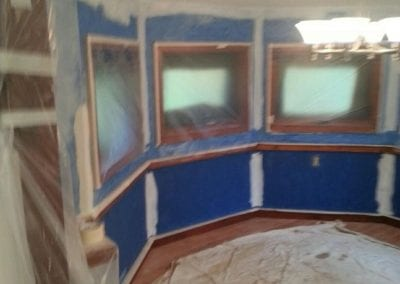 Interior of a homes room with blue walls before painting.