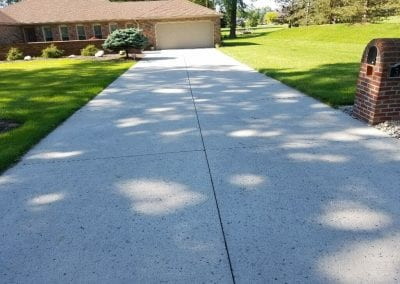 Driveway after power washing.